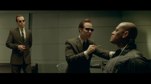 Morpheus being tortured by agents in 'The Matrix'